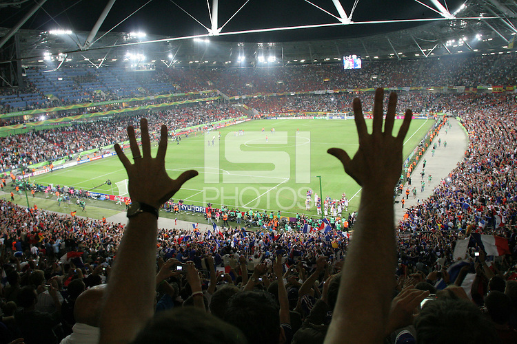 A French National soccer team supporters celebrates his national team's victory over Spain at Hannover FIFA World Cup stadium.  France defeated Spain in their  second round FIFA World Cup match in Hannover, Germany  on Tuesday, June 27th 2006 3-1.