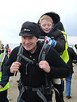 Kevin Toale and his son Fergus who took part in the St Mary's Drumcar 5K run on Bettystown beach. Photo:Colin Bell/pressphotos.ie