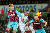 Nikica Jelavic of West Ham United and Andre Ayew look on as James Collins of West Ham United heads the ball during the Barclays Premier League match between Swansea City and West Ham United played at the Liberty Stadium, Swansea  on December 20th 2015