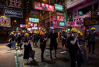Anti-Extradition Bill protestors take shelter from police on a side street during a protest in Mong Kok, Kowloon, Hong Kong, China, 04 August 2019.