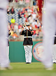 12 April 2012: A Marine Trumpeter plays the National Anthem on Opening Day prior to a game between the Washington Nationals and the Cincinnati Reds at Nationals Park in Washington, DC. The Nationals defeated the Reds 3-2 in 10 innings to take the first game of their 4-game series. Mandatory Credit: Ed Wolfstein Photo