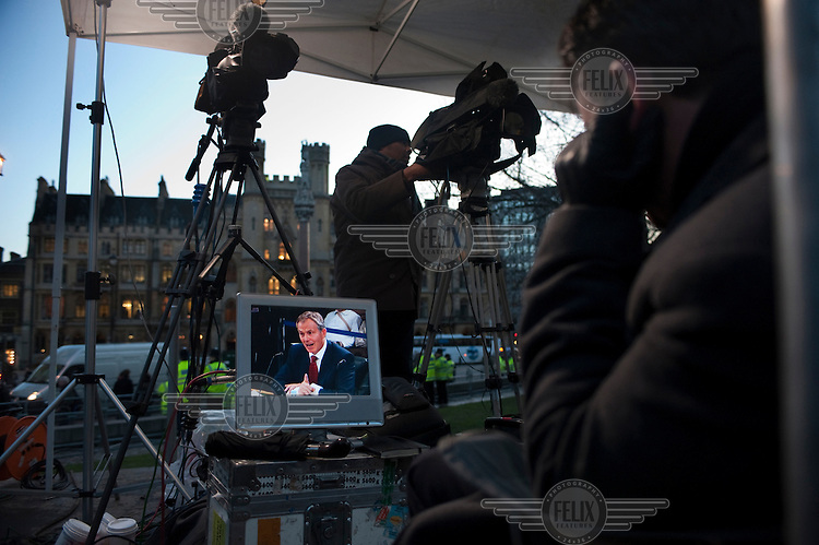 TV journalists watch Tony Blair on a monitor as they wait outside the Chilcot Inquiry where the former Prime Minister was giving evidence regarding the run-up to the Iraq war, the subsequent military action and its aftermath..