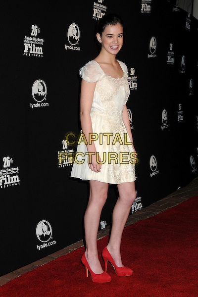 HAILEE STEINFELD .2011 Santa Barbara Film Festival - Virtuosos Awards held at the Lobero Theatre,  Santa Barbara, California, USA, 4th February 2011..full length cream white dress hand on hip red shoes .CAP/ADM/BP.©Byron Purvis/AdMedia/Capital Pictures.