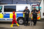 © Joel Goodman - 07973 332324. 30/07/2017 . Manchester , UK . The Flash (Ben Campey, eight from Hull) walks by police who are watching over crowds at the venue . Cosplayers, families and guests at Comic Con at the Manchester Central Convention Centre . Photo credit : Joel Goodman