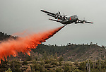 California Air National Guard C-130 drops retardant on Division S, below Pilot Peak, at Old Yosemite Road, to protect the Greeley Hill community after spot fire escaped the southwest corner of the Rim Fire the night before.