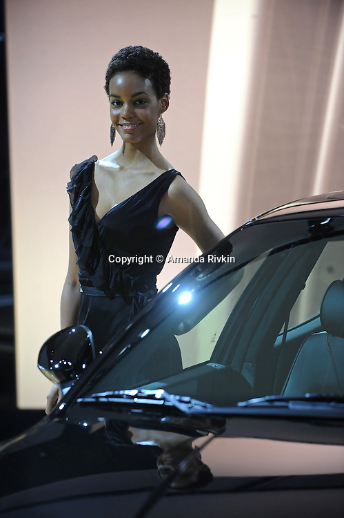 A model poses beside a Maserati at the Detroit Auto Show in Detroit, Michigan on January 12, 2009.
