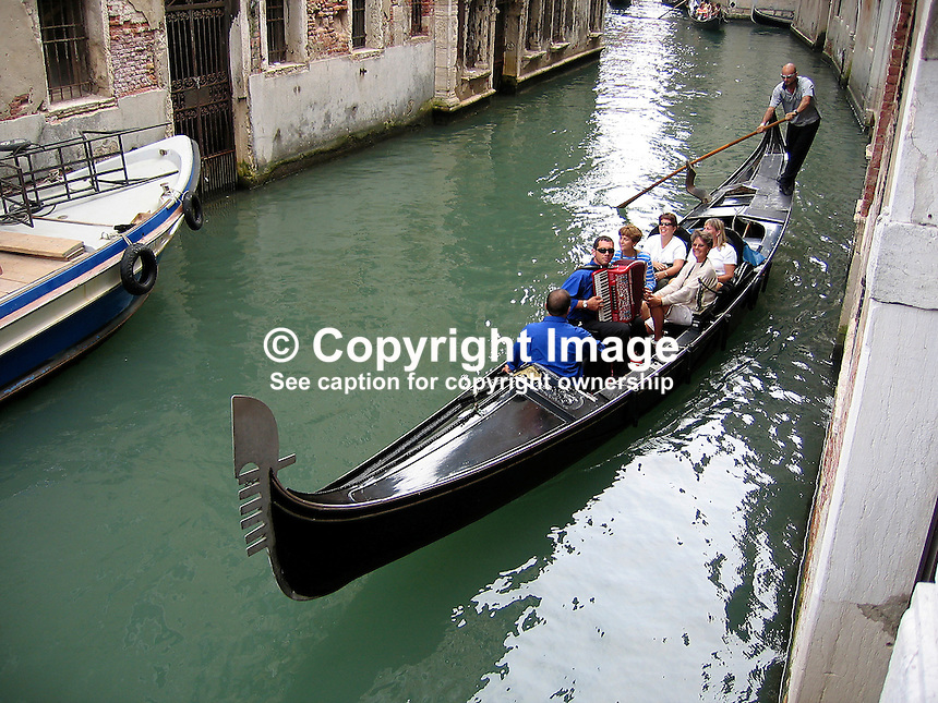 Visitors have a gondola trip with the services of an accordionist in Venice, Italy, 200609140272..Copyright Image from Victor Patterson, 54 Dorchester Park, Belfast, UK, BT9 6RJ..Tel: +44 28 9066 1296.Mob: +44 7802 353836.Voicemail +44 20 8816 7153.Skype: victorpattersonbelfast.Email: victorpatterson@mac.com.Email: victorpatterson@ireland.com (back-up)..IMPORTANT: If you wish to use this image or any other of my images please go to www.victorpatterson.com and click on the Terms & Conditions. Then contact me by email or phone with the reference number(s) of the image(s) concerned.