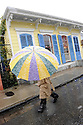 Snow falls in the French Quarter in New Orleans as a man walks down Bourbon Street, Thursday, Dec. 11, 2008....(AP Photo/Cheryl Gerber)