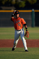 AZL Giants Orange third baseman Luis Toribio (22) throws to first base during a game against the AZL Angels at Giants Baseball Complex on June 17, 2019 in Scottsdale, Arizona. AZL Giants Orange defeated AZL Angels 8-4. (Zachary Lucy/Four Seam Images)