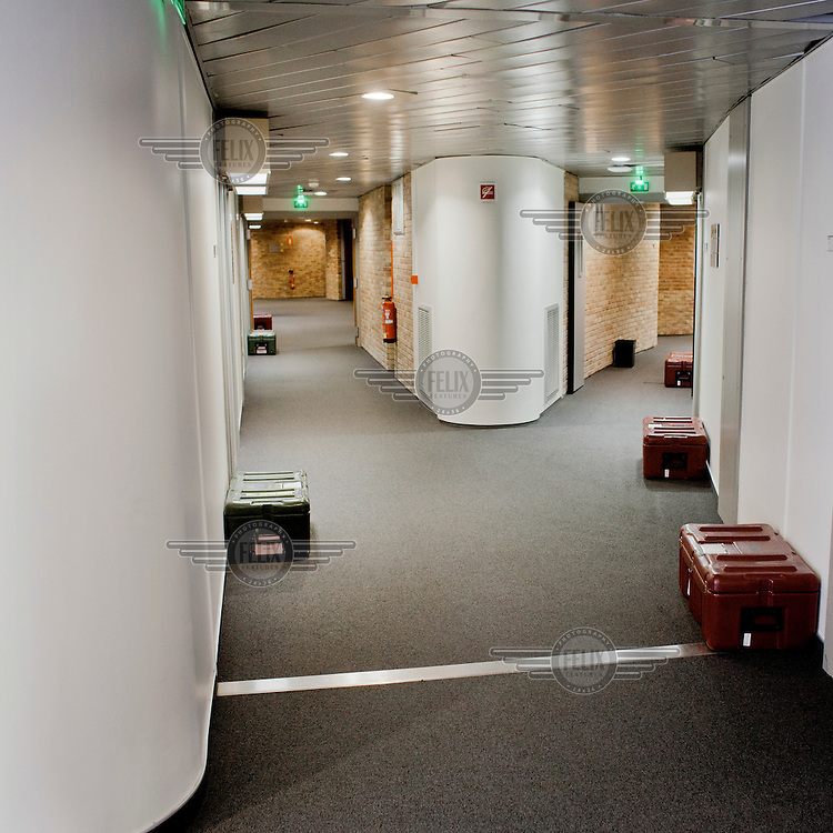 A container, known as a 'cantine', in which official documents are transported between European sites in Brussels, Strasbourg and Luxembourg, sits outside an office door in the European Parliament waiting for its owner to arrive. Every month thousands of the parliament's employees travel back and forth between the three sites of European government, Brussels, Strasbourg and Luxembourg, bringing huge quantities of paperwork with them.