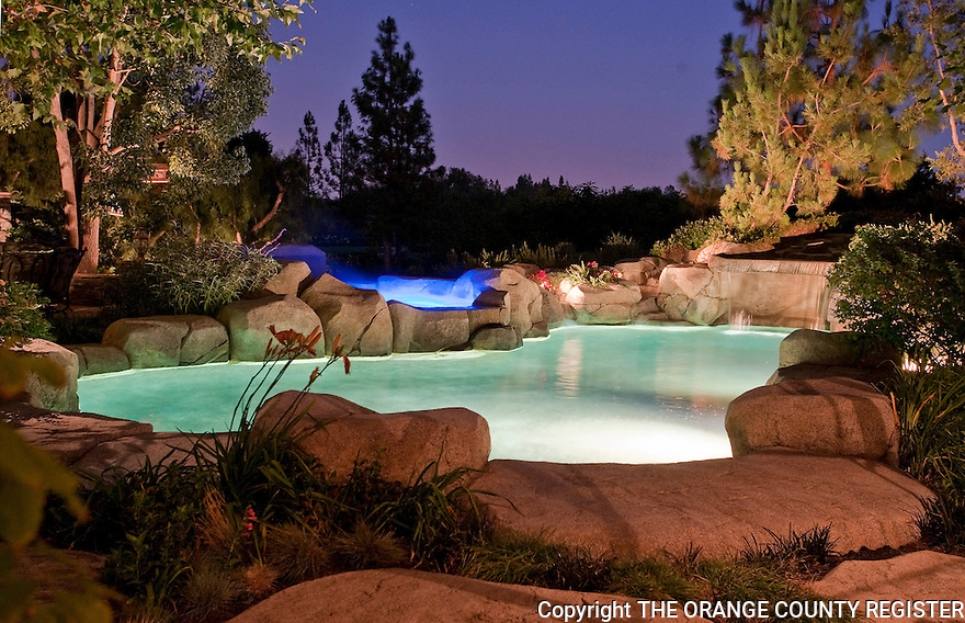 Sharon and Tony Domenico's Laguna Hills backyard pool and Jacuzzi glow with light at dusk.  The Jazuzzi light can be programmed to a variety of lighting schemes. Portfolio only.