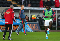 Bafetibis Gomis of Swansea City warms up before the Barclays Premier League match between Swansea City and West Ham United played at The Liberty Stadium, Swansea on 20th December 2015