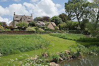 A path leads from the more formal walled garden to the wildflower meadow and ponds to the rear of the house