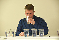 """NWA Democrat-Gazette/FLIP PUTTHOFF<br />BEST TASTING WATER<br />Brent Hutchins judges tap water from six Northwest Arkansas providers on Wednesday March 14 2018 in an annual contest at the Center for Nonprofits in Rogers to determine whose water tastes best. Rogers Water Utilities and Springdale Water Utilities tied for victory, so a sudden death """"taste-off"""" was held. Rogers was declared the winner. The contest was part of the monthly meeting of the northwest district of Arkansas Water Works and Water Environment Association, said Brad Stewart, district chairman."""