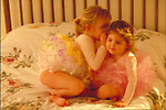 young girl ballerinas whispering and playing on bed