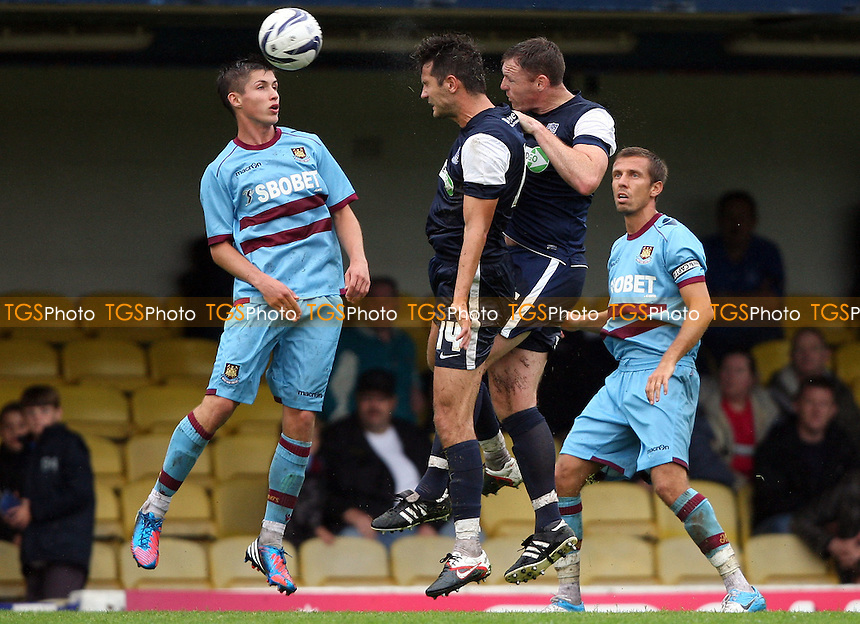 Daniel Potts of West Ham cannot stop Mark Phillips of Southend getting in a header - Southend United vs West Ham United, Pre-season Friendly at Roots Hall, Southend - 14/07/12 - MANDATORY CREDIT: Rob Newell/TGSPHOTO - Self billing applies where appropriate - 0845 094 6026 - contact@tgsphoto.co.uk - NO UNPAID USE..