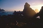 Woman in contemplation, Olympic National Park, Point of the Arches, Sea stacks, sunset, Washington State, Pacific Northwest, Pacific Ocean, USA, Point of Arches was originally purchased for preservation by The Nature Conservancy, Sarah Shannon, released,.
