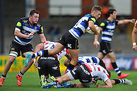 Darren Atkins of Bath Rugby takes on the Gloucester defence. West Country Challenge Cup match, between Gloucester Rugby and Bath Rugby on September 13, 2015 at the Memorial Stadium in Bristol, England. Photo by: Patrick Khachfe / Onside Images