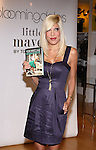 NEW YORK - SEPTEMBER 12:  Tori Spelling holds a copy of her book Mommywood while she promotes Little Maven at Bloomingdale's on September 12, 2009 in New York City.  (Photo by Donald Bowers)