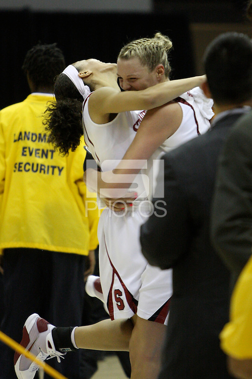 BERKELEY, CA - MARCH 30: Ros Gold-Onwude congratulates Jayne Appel on her record breaking night during Stanford's 74-53 win against the Iowa State Cyclones on March 30, 2009 at Haas Pavilion in Berkeley, California.