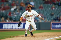 Cam Williams (55) of the Texas Longhorns takes his lead off of third base against the Arkansas Razorbacks in game six of the 2020 Shriners Hospitals for Children College Classic at Minute Maid Park on February 28, 2020 in Houston, Texas. The Longhorns defeated the Razorbacks 8-7. (Brian Westerholt/Four Seam Images)