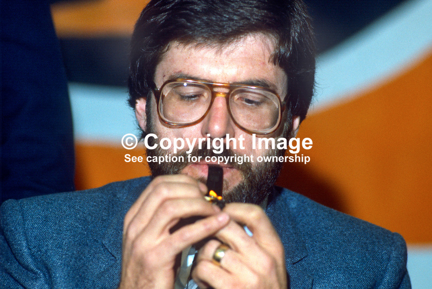 Gerry Adams, president, Provisional Sinn Fein, lights his pipe, pre smoking ban days, at his party's annual conference, ard fheis, Dublin, Rep of Ireland, 1984. 19840130GA4..Copyright Image from Victor Patterson, 54 Dorchester Park, Belfast, UK, BT9 6RJ..Tel: +44 28 9066 1296.Mob: +44 7802 353836.Voicemail +44 20 8816 7153.Skype: victorpattersonbelfast.Email: victorpatterson@me.com.Email: victorpatterson@ireland.com (back-up)..IMPORTANT: If you wish to use this image or any other of my images please go to www.victorpatterson.com and click on the Terms & Conditions. Then contact me by email or phone with the reference number(s) of the image(s) concerned.