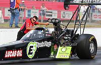 May 15, 2015; Commerce, GA, USA; A crew member with NHRA top fuel driver Morgan Lucas during qualifying for the Southern Nationals at Atlanta Dragway. Mandatory Credit: Mark J. Rebilas-USA TODAY Sports