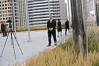 A bodyguard stands watch before the topping-off ceremony on the sixteenth floor observation deck of the new 92 story tall Trump International Hotel and Tower building in Chicago, Illinois on September 24, 2008.  The building will be the tallest in North America upon its completion in six months.
