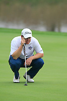 George Coetzee (RSA) on the 9th green during Saturay's Round 3 of the 2014 BMW Masters held at Lake Malaren, Shanghai, China. 1st November 2014.<br /> Picture: Eoin Clarke www.golffile.ie