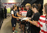 BOCA RATON, FL - DECEMBER 15, 2012: Tobinn Heath (17) of the USA WNT signs autographs at the end of an international friendly match against China  at FAU Stadium, in Boca Raton, Florida, on Saturday, December 15, 2012. USA won 4-1.