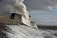 Pictured: Waves crash against the promenade wall by the Lighthouse in Porthcawl, south Wales, UK. Thursday 29 November 2018<br /> Re: Strong wionds and rain caused by Storm Diana in parts of the UK.