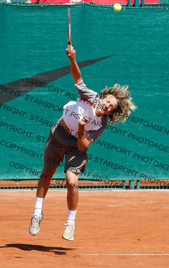 Tennis, world championship, U-14.France Vs. Canada.Lucas Pouille (FRA)-Edward Nguyen (CAN).Lucas Pouille.Prostejov, 08.07.2008..Photo: Srdjan Stevanovic.