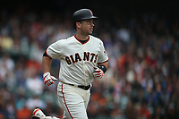 SAN FRANCISCO, CA - AUGUST 9:  Buster Posey #28 of the San Francisco Giants runs to first base against the Chicago Cubs during the game at AT&T Park on Wednesday, August 9, 2017 in San Francisco, California. (Photo by Brad Mangin)