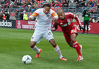 20 April 2013:Toronto FC forward Robert Earnshaw #10 and Houston Dynamo midfielder Ricardo Clark #13 in action during the first half in an MLS game between the Houston Dynamo and Toronto FC at BMO Field in Toronto, Ontario Canada...