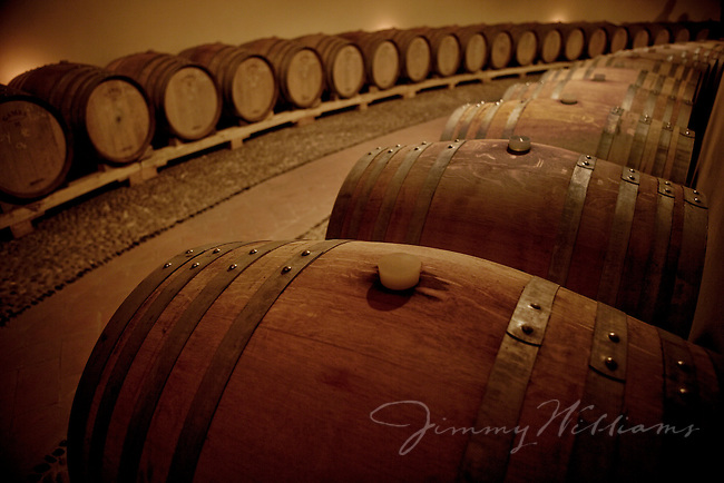 Wine barrells in a cellar in Italy.