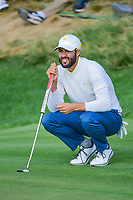 Adam Hadwin (CAN) lines up his putt on 14 during round 3 Foursomes of the 2017 President's Cup, Liberty National Golf Club, Jersey City, New Jersey, USA. 9/30/2017.<br /> Picture: Golffile | Ken Murray<br /> <br /> All photo usage must carry mandatory copyright credit (&copy; Golffile | Ken Murray)