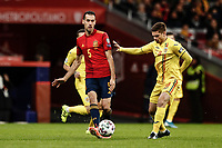 18th November 2019; Wanda Metropolitano Stadium, Madrid, Spain; European Championships 2020 Qualifier, Spain versus Romania;  Sergio Busquets (esp)  passes before the challenge from Marin of Romania - Editorial Use