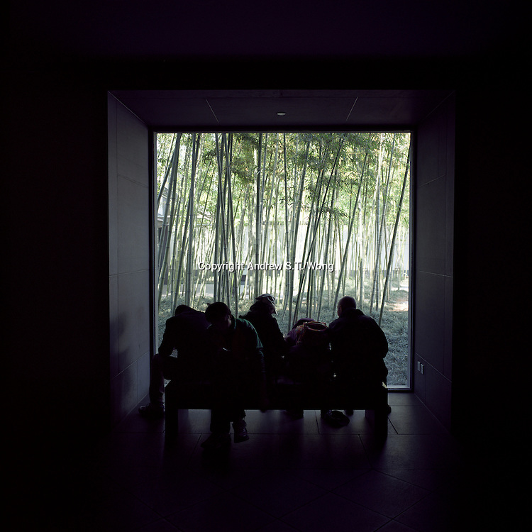 Visitors sit on a bench at Suzhou Museum against a backdrop of a bamboo garden in Suzhou, Jiangsu province, 2012. (Mamiya 6, 75mm, Kodak Ektar 100 film)