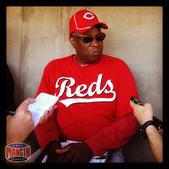 PHOENIX, AZ - Instagram of Cincinnati Reds manager Dusty Baker talking to the media in the dugout before the spring training game against the Oakland Athletics at Phoenix Municipal Stadium on March 10, 2012 in Phoenix, Arizona. (Photo by Brad Mangin)