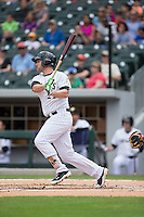 Matt Davidson (22) of the Charlotte Knights follows through on his swing against the Gwinnett Braves at BB&T BallPark on May 22, 2016 in Charlotte, North Carolina.  The Knights defeated the Braves 9-8 in 11 innings.  (Brian Westerholt/Four Seam Images)