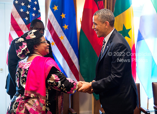 United States President Barack Obama shakes hands with President Joyce Banda of Malawi in the Cabinet Room of the White House in Washington, D.C., U.S., on Thursday, March 28, 2013. Also attending the meeting were President Macky Sall, of Senegal, President Ernest Bai Koroma, of Sierra Leone, and Prime Minister JosÈ Maria Pereira Neves, of Cape Verde. .Credit: Joshua Roberts / Pool via CNP