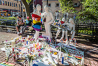 New York, USA 14 June 2016 - Vigil for the Lives Lost in Orlando -  In the wake of the mass shooting  that left at 49 people dead and 50 others wounded at Pulse, a gay nightclub in Orlando, Florida.a silent vigil continues in CHristopher Park, Stonewall Place. The George Segal sculpture, entitled Gay Liberation, is adorned with a rainbow flag, flowers, notes and candles.<br />