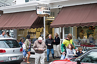 People walk past Murdick's Fudge on North Water Street in Edgartown, Martha's Vineyard, Massachusetts, USA, on Tues., July 25, 2017.  Other companies on Martha's Vineyard and around the US had difficulty obtaining H2B visas, but Murdick's Fudge received all it requested.