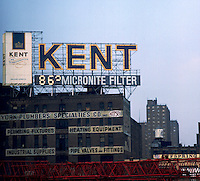 Advertisment for Kent cigarettes and temperature on top of Manhattan building. New York city, circa 1975.