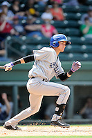 Shortstop Emerson Jimenez (14) of the Asheville Tourists bats in a game against the Greenville Drive on Sunday, July 20, 2014, at Fluor Field at the West End in Greenville, South Carolina. Asheville won game one of a doubleheader, 3-1. (Tom Priddy/Four Seam Images)
