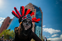 A Mexican girl, wearing a feather headgear inspired by Aztecs, dances on the street during the Day of the Dead procession in Mexico City, Mexico, 29 October 2016. Day of the Dead (Día de Muertos), a syncretic religious holiday combining the death veneration rituals of the ancient Aztec culture with the Catholic practice, is celebrated throughout all Mexico. Based on the belief that the souls of the departed may come back to this world on that day, people gather at the gravesites in cemeteries praying, drinking and playing music, to joyfully remember friends or family members who have died and to support their souls on the spiritual journey.