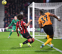 23rd November 2019; Vitality Stadium, Bournemouth, Dorset, England; English Premier League Football, Bournemouth Athletic versus Wolverhampton Wanderers; Adama Traore of Wolverhampton Wanderers gets his cross in under pressure from Nathan Ake of Bournemouth - Strictly Editorial Use Only. No use with unauthorized audio, video, data, fixture lists, club/league logos or 'live' services. Online in-match use limited to 120 images, no video emulation. No use in betting, games or single club/league/player publications