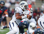 Nevada's Don Jackson runs against Arizona an NCAA college football game in Reno, Nev., on Saturday, Sept. 12, 2015.(AP Photo/Cathleen Allison)