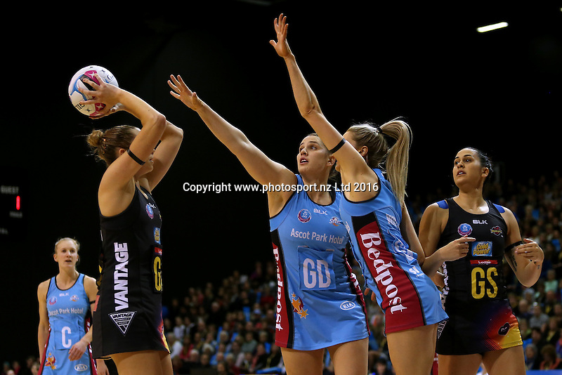 Jo Harten (L) of the Magic  attempts a shot at goal while defended by Te Huinga Selby-Rickit and Jane Watson of the Steel during the ANZ Championship netball match between the Southern Steel and Waikato Bay of Plenty Magic, ILT Stadium Southland, Invercargill, Sunday, June 19, 2016. Photo: Dianne Manson / www.photosport.nz