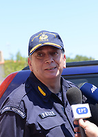 Pictured: A police officer speaks to the media in Ikaria, Greece. Thursday 08 August 2019<br /> Re: Rescuers searching for  British scientist Natalie Christopher, 35, who disappeared on the  island of Ikaria, Greece have found her body at the bottom of a ravine.<br /> She was found less than a mile from the hotel in the Kerame area where she was on holiday with her Cypriot partner.<br /> Emergency service staff said that a large rock had dislodged as she fell, causing multiple head injuries.<br /> The woman's body will be kept overnight at the spot so a coroner can examine it on Thursday morning.